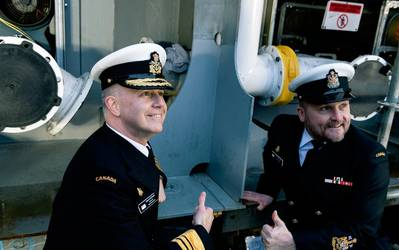 Vice Admiral Art McDonald, Commander of the Royal Canadian Navy (left), along with Royal Canadian Navy Command Chief Petty Officer First Class David Steeves (right) laying the ceremonial coin on the future HMCS Protecteur's keel. (Photo: Seaspan Shipyards)