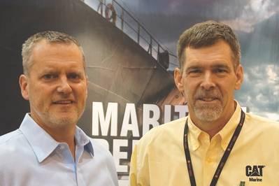 """TE """"Dra"""" Wiersema (rechts), Produktmanager Caterpillar Marine, sprach mit Greg Trauthwein (links) für Maritime Reporter TV in New Orleans über den neuen Multi-Engine Optimizer (MEO) von Caterpillar. (Foto: Eric Haun)"""