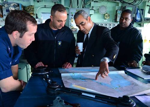 SUEZ CANAL (April 5, 2013) Egyptian pilot Mohamed El-Said shows Sailors a Suez Canal chart aboard the amphibious dock landing ship USS Carter Hall (LSD 50) as they begin a transit of the canal as part of the Kearsarge Amphibious Ready Group with the embarked 26th Marine Expeditionary Unit.  (U.S. Navy photo by Mass Communication Specialist 3rd Class Chelsea Mandello)