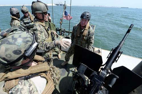 NAVAL SUPPORT ACTIVITY BAHRAIN (Aug. 28, 2013) Lt. Bryce Brown, assigned to Commander, Task Group (CTG) 56.11, discusses the capabilities of the Riverine Command Boat (RCB) to Vice Adm. John W. Miller, commander of U.S. Naval Forces Central Command, U.S. 5th Fleet, Combined Maritime Forces, during a display of capabilities of Commander, Task Force (CTF) 56.