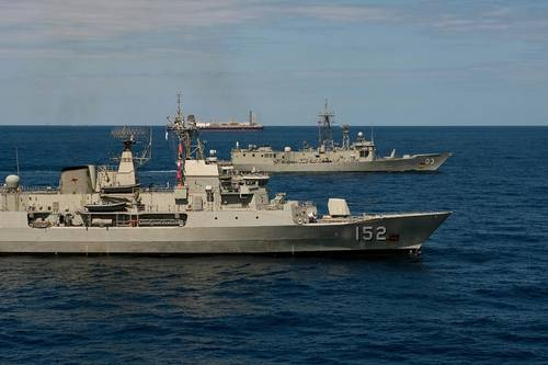 HMA Ships Warramunga (FFH-152) and Sydney (FFG-03) conducts a patrol in the vicinity of the oil production facility, the Modec Venture II, 150km off the north west coast of Australia as part of Ex Blue Raptor 2013. Photo: LSIS Brenton Friend