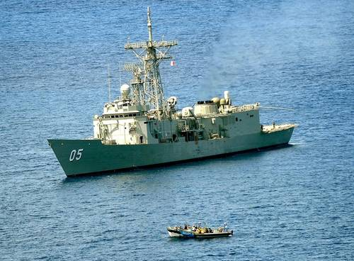 HMAS Melbourne closes on a suspected pirate vessel in the Arabian Sea. (Photo: POA Damien Cox)