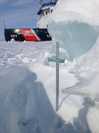 A yardstick measures the thickness of some of the ice that the crew of Coast Guard Cutter Katmai Bay is battling during ice-breaking operations in the Straits of Mackinac Feb. 5, 2014. The crew of the Katmai Bay, homeported in Sault Ste. Marie, Mich., along with the crew of Coast Guard Cutter Bristol Bay, homeported in Detroit, have spent the past few days trying to keep the Straits open to shipping traffic. (U.S. Coast Guard photo by Lt. Michael Patterson)