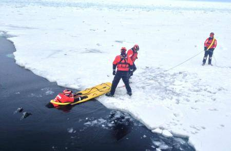 Crew members of Coast Guard Cutter Katmai Bay, homeported in Sault Ste. Marie, Mich., practice ice rescue techniques in the Straits of Mackinac Feb. 4, 2014. (U.S. Coast Guard photo by Seaman Paul Walker)