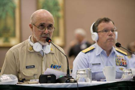 Vice Adm. Fernando Castañón Zamacona, commander of the Mexican Navy's Zone 1, and Rear Adm. Cook, the U.S. Coast Guard's 8th District commander, discuss updates to the MEXUSGULF plan. (USCG photo by Andrew Kendrick)