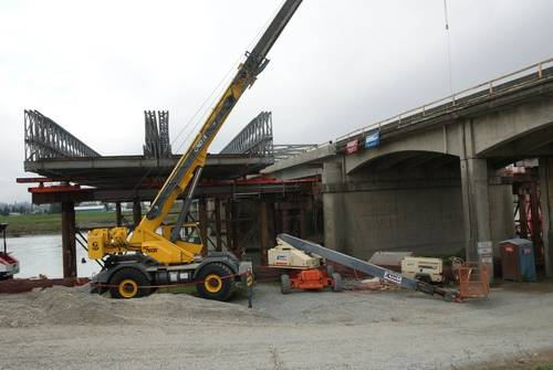 Northwest-based Omega Morgan won a bid to jack up 915-ton span and then slid it onto steel columns for the Skagit River Bridge in Washington State. This photo is of the bridges after the new span was jacked down into place. The jack-and-slide method meant traffic could get moving more quickly.  The Skagit Bridge made national news when a truckload hit several crossbeams, causing it to collapse and putting a spotlight on thousands of aging bridges across the nation. (Photo courtesy Omega Morgan.)