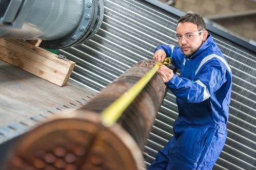 Engineering technician Craig Marr measures-up a heat exchanger at Ross Offshore's Peterseat Road facility.