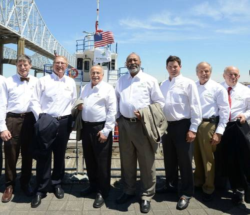 Members of the Board of Commissioners of the Port of New Orleans are joined by Port President and CEO Gary LaGrange wearing shirts with the port's new logo while the new port flag flies above the Gen. Roy S. Kelley fireboat. Pictured Commissioner Joseph F. Toomy, Mr. LaGrange, Commissioner William T. Bergeron, Board Chairman Daniel F. Packer, Board Secretary-Treasurer Scott H. Cooper, Commissioner Michael W. Kearney and Commissioner Robert Barkerding Jr.