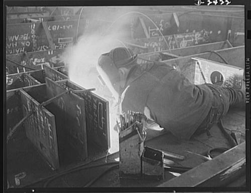 Welding is more important than ever  before in shipbuilding, saving time, weight and steel. (Photo Credit: Library of Congress)