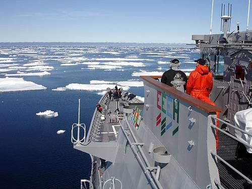Ship's Serviceman Seaman Recruit Jamal Powell, left, and Seaman Recruit Stephen Harmon stand forward lookout watch aboard guided-missile cruiser USS Normandy (CG 60) as the ship navigates an ice field north of Iceland. U.S. Navy photo by Ryan Birkelbach