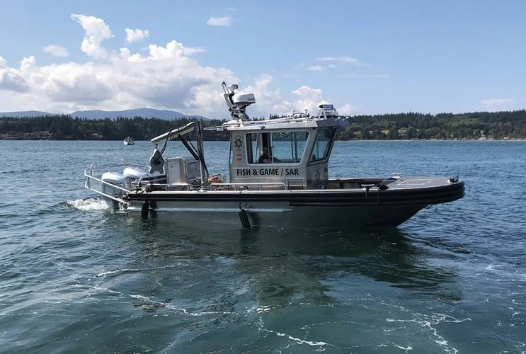 24 Workskiff M Series multi-mission vessel with walk around pilot house for the Tulalip Indian Fish and Game Agency for fisheries management, law enforcement, search and rescue and fire fighting. Naval architecture and marine engineering by Boksa Marine Design.