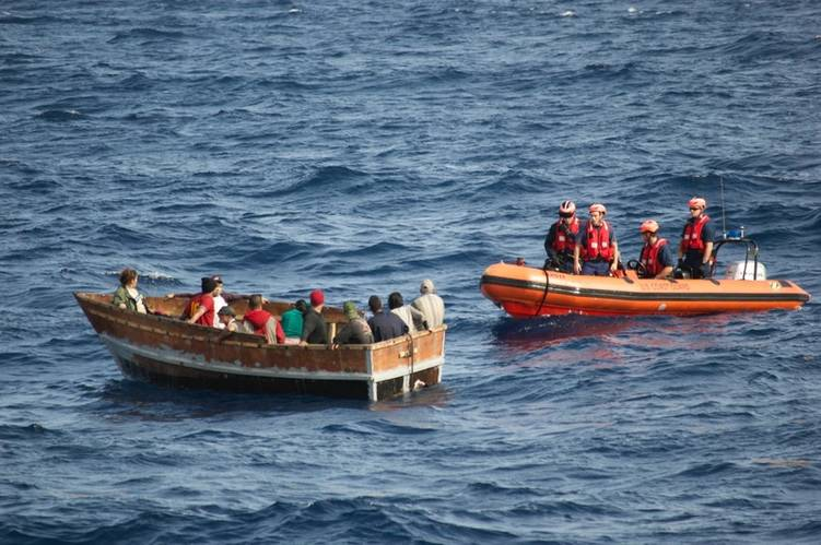 A boatcrew with the Coast Guard Cutter Knight Island approaches a rustic vessel southwest of Key West, Florida, Dec. 30., 2014. The rustic vessel had 12 Cuban migrants aboard who were later repatriated to Bahia de Cabañas, Cuba, Jan. 5, 2015. (U.S. Coast Guard photo)
