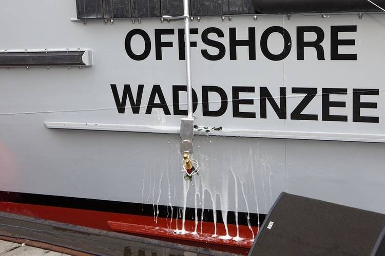 A bottle is broken on Offshore Waddenzee during a christening ceremony at Damen Oranjewerf Amsterdam (Photo: Damen)