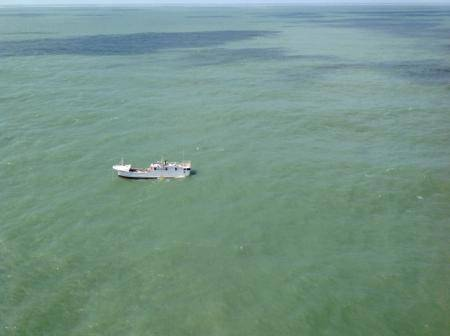 A Coast Guard Air Station Houston aircrew checks out a derelict vessel, Rich, Wednesday, Sept. 3, 2014, located southeast of Freeport. The vessel was found and reported by a passing vessel, the Lady Glenda, and it eventually went aground Sept. 4 about 20 miles south of Freeport. USCG photo