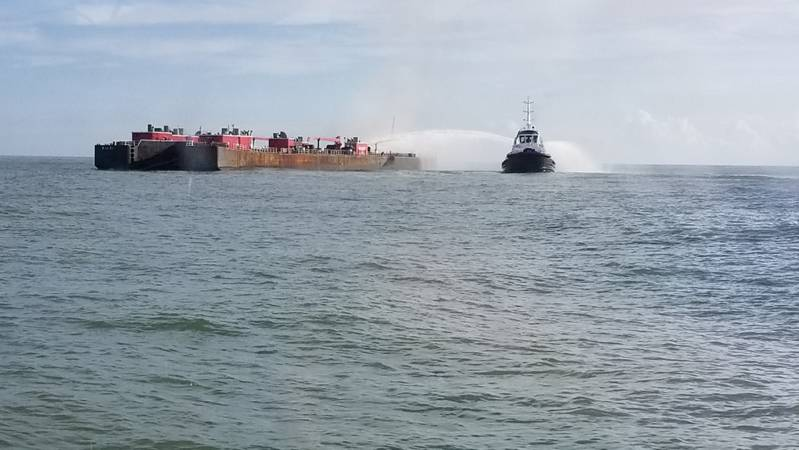 A Corpus Christi Fire Department vessel attempts to extinguish a fire onboard a barge approximately three miles from the Port Aransas, Texas. (U.S. Coast Guard photo)