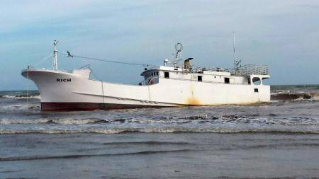 A derelict vessel, Rich, aground on Sargent Beach Thursday, located about 20 miles south of Freeport. USCG photo