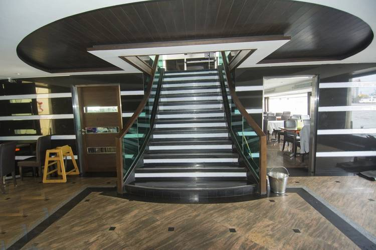 A grand staircase connects the upper and lower passenger decks. (Photo credit: Haig-Brown/Cummins Marine)