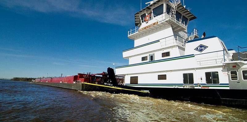 A Kirby inland pushboat with barges (Kirby)