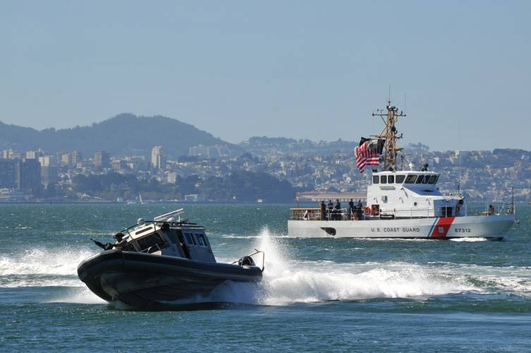 A Marine Safety and Security Team 91109 San Diego small boat and the Coast Guard Cutter Hawksbill conduct training in San Francisco Sept. 17, 2014. Credit: USCG Photo, Patrick Kelley, Photographer to the Commandant