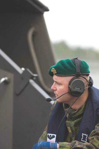 A member of the amphibious arm of the Finnish Navy, a Finnish Coastal Jaeger, equipped with IMP headset and PCU. Image credit: Savox Communications