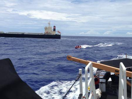 A Navy HSC-25 helicopter crew medically evacuated an injured crewmember from a cargo ship approximately 362 miles east of Guam Monday morning. (U.S. Coast Guard photo)