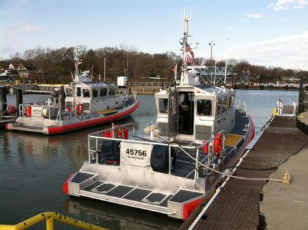 A new 45-foot response boat (right) is moored at Coast Guard Station Marblehead, Ohio, after the station's crew accepted it May 1, 2014. (U.S. Coast Guard photo by Phillip Null)