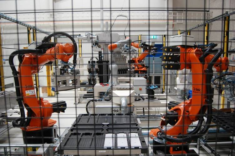A robot's battle against emissions: Siemens articulated robots of different sizes assemble battery stacks at Trondheim, Norway.  Credit: William Stoichevski
