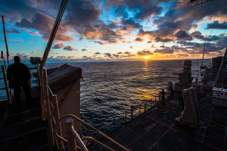 A Sailor observes the sunset aboard the guided-missile cruiser USS Bunker Hill (CG 52) (U.S. Navy photo by Peter G. Suess)