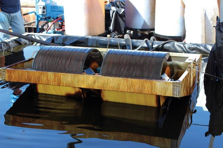 A skimmer was tested in controlled conditions to evaluate the impact dispersant mixed with crude oil has on skimmer performance. Image: Courtesy Ohmsett