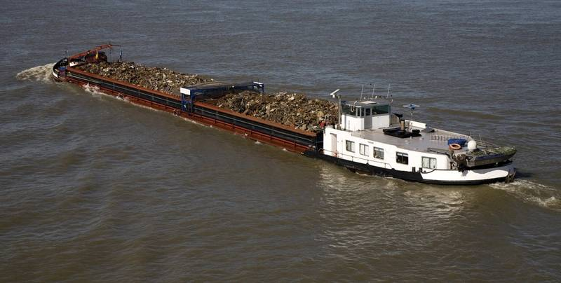 A typical inland pushboat working with a barge. (Courtesy: Helm)