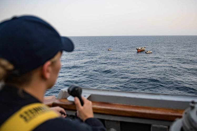 A U.S. Navy Ensign conns from the bridge wing of USS Jason Dunham (DDG 109) as the ship's visit, board, search and seizure team inspects a dhow. (U.S. Navy photo by Jonathan Clay)