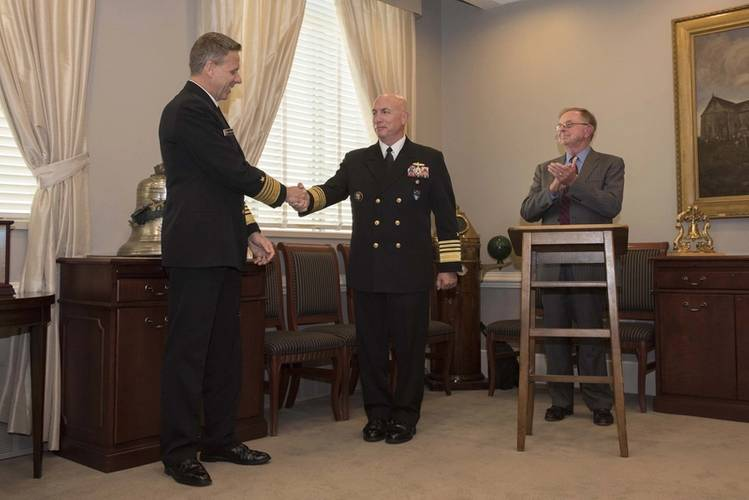 Adm. Kurt W. Tidd, commander of U.S. Southern Command, right, shakes hands with Adm. Phil Davidson, commander of U.S. Indo-Pacific Command, after turning over the Old Salt Award during a ceremony at the Pentagon. Davidson received the Old Salt award which is sponsored by the Surface Navy Association (SNA) and is given to the longest serving active-duty officer who is surface warfare officer (SWO) qualified. (U.S. Navy photo by Mass Communication Specialist 2nd Class Paul L. Archer/Released)