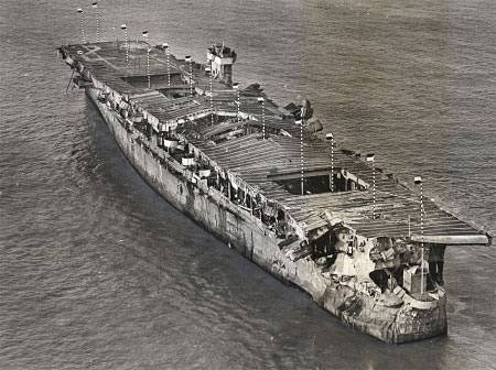 Aerial view of ex-USS Independence at anchor in San Francisco Bay, California, January 1951. There is visible damage from the atomic bomb tests at Bikini Atoll. (Credit: San Francisco Maritime National Historical Park, P82-019a.3090pl_SAFR 19106)