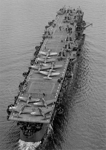 """Aerial view of USS Independence (CVL 22) underway July 15, 1943 in San Francisco Bay, California. Before departing San Francisco, USS Independence's hull classification changed from CV 22 """"aircraft carrier"""" to CVL 22, """"light aircraft carrier."""" (Credit: U.S. Navy, National Archives, 80-74436)"""