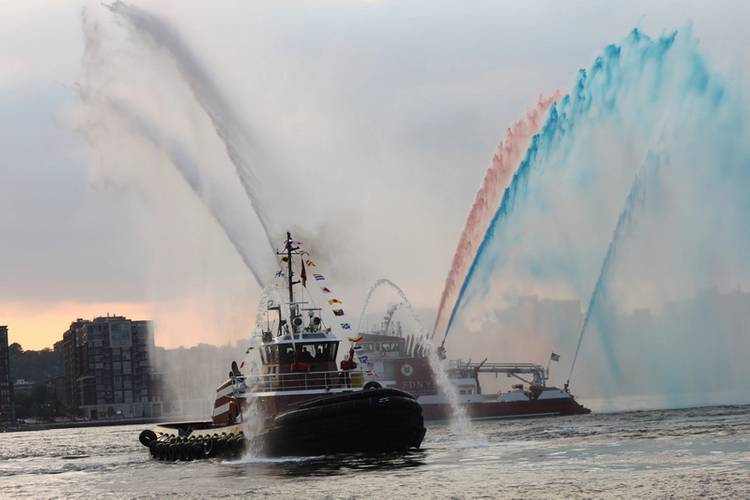 After the christening, the NYFD Fireboat 343 helps celebrate with red, white and blue streams of water. . (Photo: Greg Trauthwein)