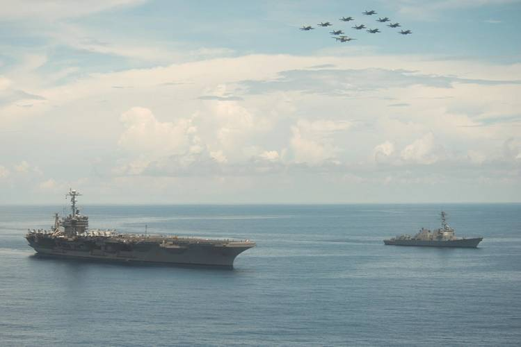 Aircraft assigned to Carrier Air Wing (CVW) 9 fly in formation above USS John C. Stennis (CVN 74) and the guided-missile destroyer USS Stockdale (DDG 106) during an air-and-sea-power demonstration. Providing a ready force supporting security and stability in the Indo-Asia-Pacific, John C. Stennis is operating as part of the Great Green Fleet on a regularly scheduled 7th Fleet deployment. (U.S. Navy photo by Tomas Compian)