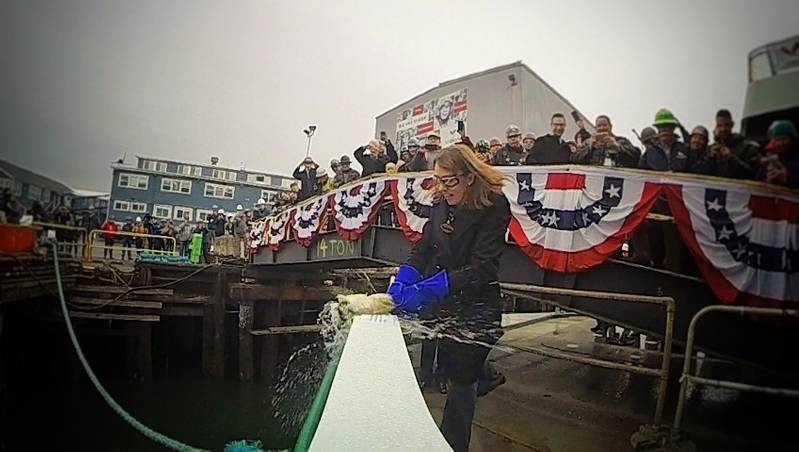 Amy Scarton, WSDOT assistant secretary, Ferries Division, christens the State's newest Olympic Class ferry, Suquamish. (Photo: WSDOT)