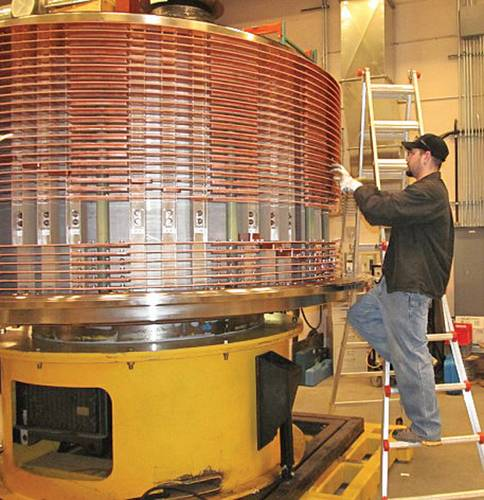 An employee works on the production of a large electrical slip ring at Moog Focal's Nova Scotia facility.