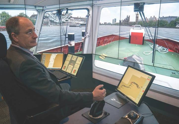 Andy Mitchell, CEO of Tideway, at the helm of a tug in the Thames simulation (Photo: HR Wallingford)