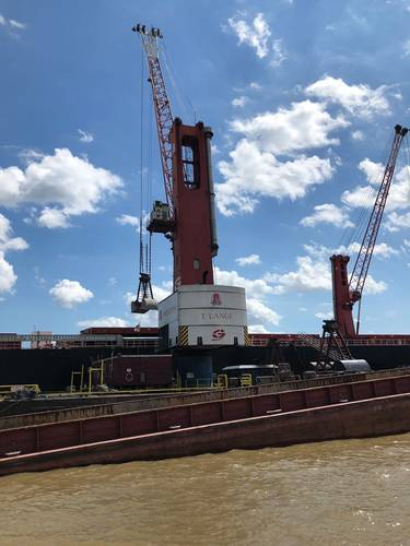 Associated Terminals & Turn Services run an impressive mid-stream cargo transfer operation in the Mississippi River. Historically high waters and swift currents in this critical waterway challenge the speed, efficiency and safety of all river-borne operations. Photo: Greg Trauthwein