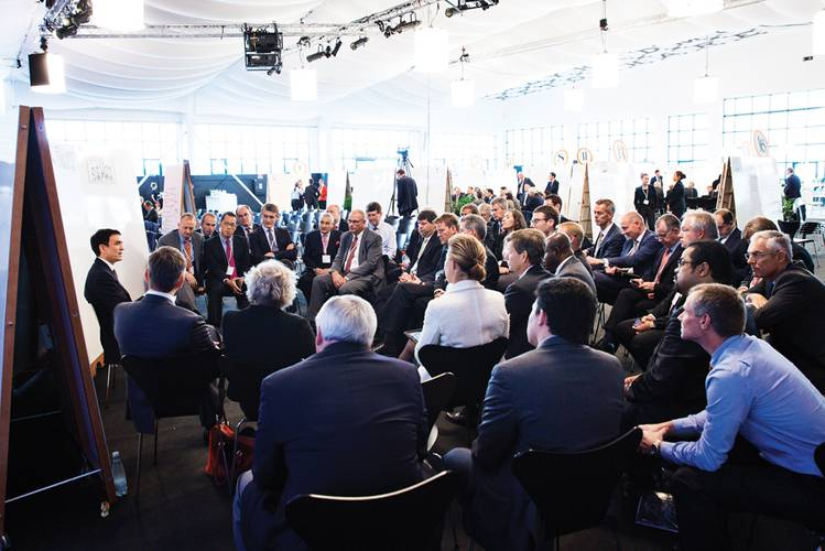 """Attendees at the Danish Maritime Forum participate in """"fireside chats."""""""