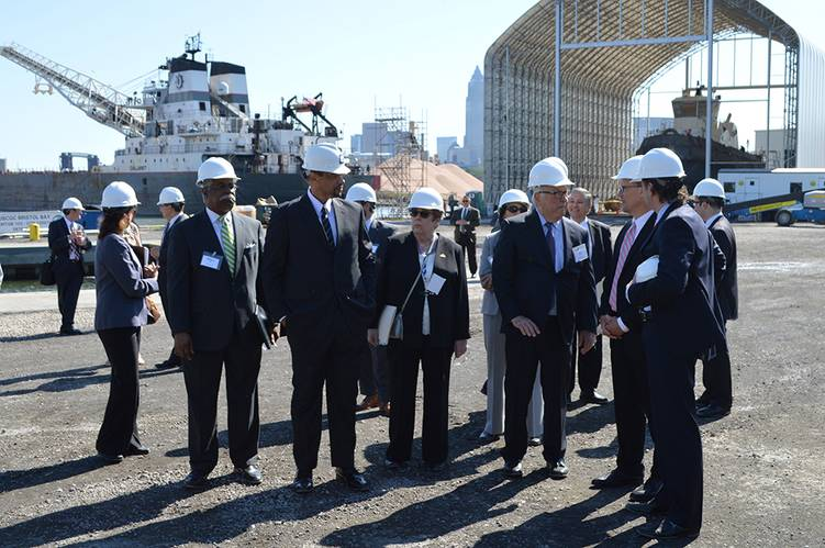 Attendees touring Great Lakes Shipyard with the SS Calumet and the Great Lakes Shipyard-built, HandySize Class, 3,400 HP twin-screw tugboat Regimen de Pensiones y Jubilaciones del Personal de la Empresa Portuaria in the background (Photo: The Great Lakes Group)
