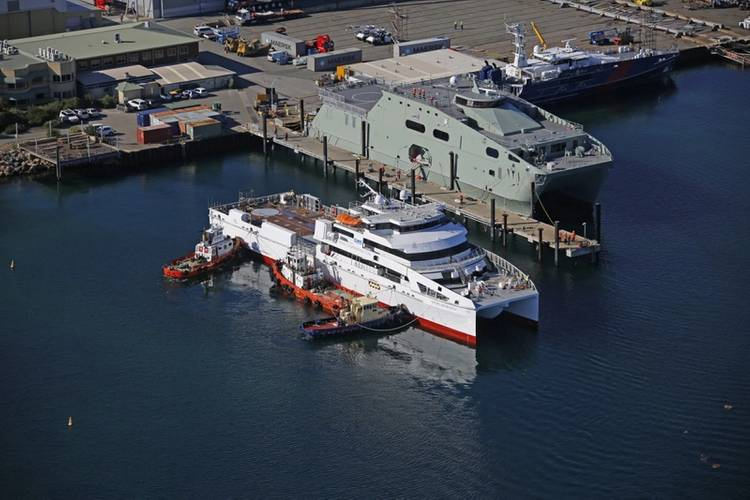 Austal Large Crew Transfer 70 (Hull 392) maneuvering alongside at Austal Australia (with Royal Navy of Oman's High Speed Support Vessel AL NAASIR (S12) and the Australian Border Force's Cape Wessell patrol boat in the background). (Photo: Austal)
