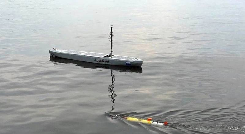 """AutoNaut """"shepherding"""" the Remus UUV during operations (the shepherding back to a safe zone was done mostly when the UUV was underwater). Photo from AutoNaut."""