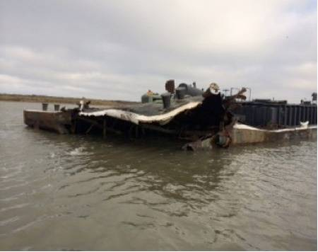 Barge collison damage: Photo courtesy of USCG