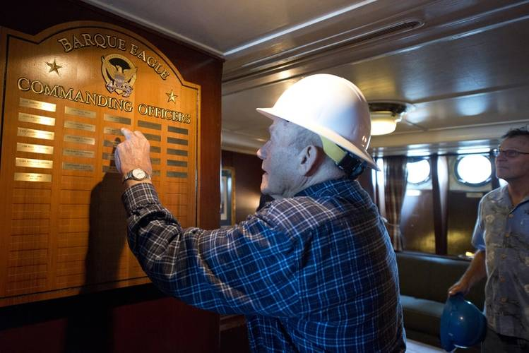Briggs points to the names of commanding officers he served with through 1947-1950. (Photo: Jasmine Mieszala)