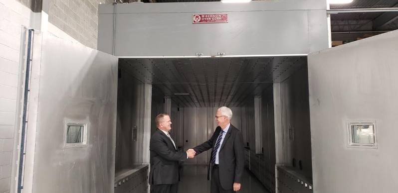 Capt. Rick Hepburn, USN (Ret), Hepburn and Sons LLC, tours the facility with TEFELEN America's President/ CEO Philip Brown.