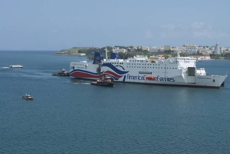 Caribbean Fantasy is towed to Pier 15 in San Juan Harbor, Puerto Rico, Saturday, Aug. 20 (U.S. Coast Guard photo by Jasmine Mieszala)