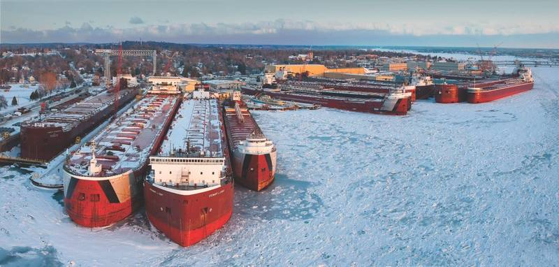 Caring for the Great Lakes fleet: during the winter months is a core business for Bay Shipbuilding Company. Pictured, the 2015 Winter Fleet. (Photo: Bay Shipbuilding)