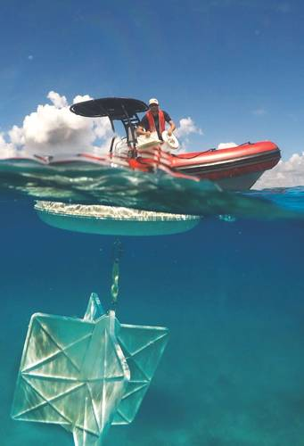 CARTHE drifter deployment from a small boat offshore Miami. (Photo: GreenWave Instruments LLC)